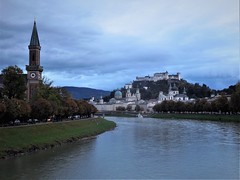 the Salzach River (SM Tham) Tags: europe austria salzburg city salzach river water landscape cityscape buildings hohensalzburg fortress churches domes towers steeples trees clock bridge boat mountain sky grass
