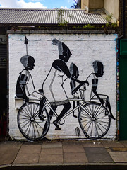 A Passenger Vehicle (Steve Taylor (Photography)) Tags: alexsenna baconstreet african senna art graffiti streetart mural blackandwhite uk gb england greatbritain unitedkingdom london cycle bike bicycle