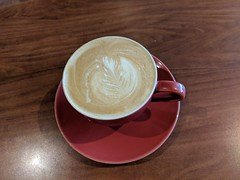 Red cup of Cappuccino on saucer with a leaf pattern in foam (Eric Broder Van Dyke) Tags: pixel2 hawaii red cup cappuccino saucer with leaf pattern foam