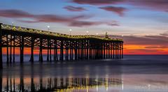 Beach Boy Christmas (ihikesandiego) Tags: pacific beach san diego sunset crystal pier christmas tree lights