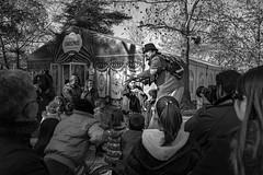 Some Magic (papkostantin) Tags: magick mages street streetphotography bnw bw monochrome streetphoto streetshot blackandwhite city xmas christmas people kids magic urban streetmages stilts k3ii pentax park larissa geece natale festive