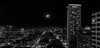 moon set over the tenderloin (pbo31) Tags: bayarea california nikon d810 color dark night black boury pbo31 lightstream motion winter december 2017 blackandwhite skyline tenderloin over view hotel civiccenter cityhall parc55 unionsquare city urban rooftops panorama large stitched panoramic hilton sanfrancisco infinity roadway traffic silhouette