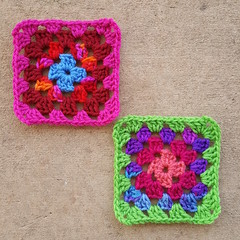 Two four-round Roseanne Reboot granny squares ready for the final round (crochetbug13) Tags: crochetbug crochetsquares grannysquares crochetblanket crochetafghan crochetthrow roseanne roseannereboot roseannesofablanket crocheted crocheting scrapyarn yarnstash