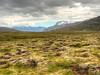 Stark beauty! (Digidoc2 - BACK) Tags: valleyofthewaterfalls plain mountains lava fileds moss grass snow clouds sky summer iceland mountainrange landscape waterfall