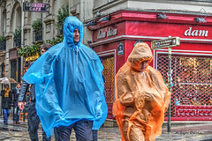rainy day-2 (albyn.davis) Tags: people couple street rain weather slicker colors colorful blue orange red vivid vibrant paris travel