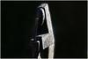 Abstraction angulaire (Pi-F) Tags: moderne abstrait art homme travail angle béton pieu bras lumière noir baton forme statue monument square sculpture