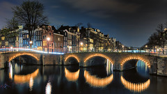 Keyser Söze (Pat Charles) Tags: amsterdam netherlands holland europe travel tourism nikon tripod longexposure night nighttime evening dusk bridge canal keizersgracht emperor reflection reflected reflections water river arch architecture architectural dutch light trails bike bicycle cars flickraward5