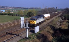 56035 is seen at Tupton possibly working the 6M99 Grimsby to Wolverhampton Steel Terminal in April 1995. I Cuthbertson collection (I C railway photo's) Tags: class56 56035 grid tupton