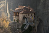 Monastery of St. Nicholas Anapausas, Meteora, Greece (spyRaw) Tags: rocks mountain zoom flags sunset shadows fog church trees