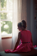 (Rebecca812) Tags: girl child vintage polkadots dress red window bench sitting seated contemplation sideview rearview canon people portrait trees summer sunlight day indoors rebeccanelson rebecca812 1950s ponytail house home
