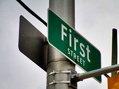 So Many First Streets ... (Haytham M.) Tags: firststreet light traffic sky post cosmopolis city town street name sign