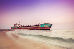 "Shipwrecked (""The Wanderer's Eye Photography"") Tags: 2017 bangalore canoneos450d canoneosdslr canoneosrebelxsi digitalphotography dusk india kerala photography rubenalexander susanalexander thewandererseyephotography time abandon abandoned accident backdrop background beach beachbackground beachscene beauty blue broken cloudless coast coastline corrosion decay disaster dredger evening hansitha horizon isolated landscape marine nature nautical ocean old outdoor pink rust rusty sand scenery scenic sea seascape seashore ship shipwreck shipwrecked shore sky stranded sundown sunset tourism transport travel tropical vessel view vivid water wave wide wreck wreckedship asia"
