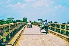Simply a bridge and a moment (Sagor's) Tags: train sky blue time moment bd bangladesh road bridge street nature natural van persons streetphoto streetphotography day dayligh sunligh light colour color colors colours nikon tamron d5300 flickrtravelaward