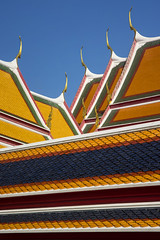 """Thailand - Bangkok - Wat Po - Temple Roofs 02_DSC6129 by Darrell Godliman - The colourful roofs of some of the temples of the Wat Po complex in Bangkok.  Click here to see photos from this and a previous trip to Thailand : www.flickr.com/photos/darrellg/albums/72157600177340620   From Wikipedia : """"Wat Pho (Thai: วัดโพธิ์), also spelt Wat Po, is a Buddhist temple complex in the Phra Nakhon District, Bangkok, Thailand. It is on Rattanakosin Island, directly south of the Grand Palace. Known also as the Temple of the Reclining Buddha, its official name is Wat Phra Chetuphon Vimolmangklararm Rajwaramahaviharn (Thai: วัดพระเชตุพนวิมลมังคลารามราชวรมหาวิหาร; rtgs: Wat Phra Chettuphon Wimonmangkhlaram Ratchaworamahawihan; The more commonly known name, Wat Pho, is a contraction of its older name Wat Photaram (Thai: วัดโพธาราม; rtgs: Wat Photharam).   The temple is first on the list of six temples in Thailand classed as the highest grade of the first-class royal temples. It is associated with King Rama I who rebuilt the temple complex on an earlier temple site, and became his main temple where some of his ashes are enshrined. The temple was later expanded and extensively renovated by Rama III. The temple complex houses the largest collection of Buddha images in Thailand, including a 46 m long reclining Buddha. The temple is considered the earliest centre for public education in Thailand, and the marble illustrations and inscriptions placed in the temple for public instructions has been recognised by UNESCO in its Memory of the World Programme. It houses a school of Thai medicine, and is also known as the birthplace of traditional Thai massage which is still taught and practiced at the temple.""""   My Website : Twitter : Facebook : Instagram  : Photocrowd  © D.Godliman"""