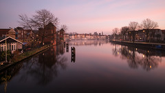 Misty River (McQuaide Photography) Tags: haarlem noordholland northholland netherlands nederland holland dutch europe sony a7rii ilce7rm2 alpha mirrorless 1635mm sonyzeiss zeiss variotessar fullframe mcquaidephotography lightroom adobe photoshop tripod manfrotto stad city urban waterside lowlight sunset zonsondergang mist mistig misty outdoor outside building longexposure cityscape sky water reflection river spaarne rivier ndfilter neutraldensity bwfilters atmosphere atmospheric calm tranquil peaceful 169 widescreen winter cold koud serene bulbmode wideangle groothoek