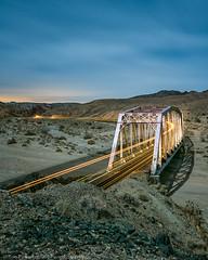 Silver and Gold (dejavue.us) Tags: d850 nikon bridge vle mojavedesert california nightphotography unionpacific 180350mmf3545 train mojaveriver fullmoon trestle nikkor longexposure desert aftoncanyon