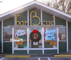 Merry Christmas & Happy New Year! (Melinda Young Stuart) Tags: store restaurant carryout bbq shelby nc roadside bridges food storefront seasonal christmas merrychristmas happynewyear memory favorite pork glass window decoration wreath holiday december landmark maindrag