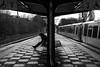 """Don't turn your back on me"" / against the symmety (Özgür Gürgey) Tags: 2017 50mm bw d750 eppendorferbaum hamburg nikon sylvester alone people platform rainy station street subway symmetry"