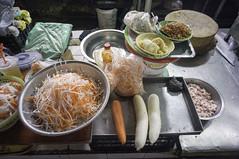around the market (kuuan) Tags: chợphúnhuận caothắng voigtländerheliarf4515mm manualfocus mf voigtländer15mm aspherical f4515mm superwideheliar sonynex5n apsc hochiminhcity hcmc saigon vietnam street market carrot crated