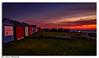 ''Huts'' (marcbryans) Tags: portlandbill dorset uk wideangle sunrise outdoors ocean orange seascape huts light coast colours nikond500 nikkor1755mmf28 boat fishing