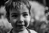 Nephew (AWLancaster) Tags: portrait logan bw monochrome nephew child smiling happy headshot canon lightroom backyard shepparton eyes people portraits bokeh dof
