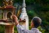Wat Phnom 1 2017 full_DSC4724 (BryonLippincott) Tags: cambodia cambodian cambodianculture phnompenh temple buddhism buddhist buddhisttemple watphnom wat asia southeast southeastasia stupa bluesky worship religion faithful merit landmark historic tourism tourist destination architecture history building incense shrine spirithouse man