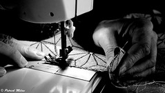 Sewing (patrick_milan) Tags: sewing work woman hand finger light