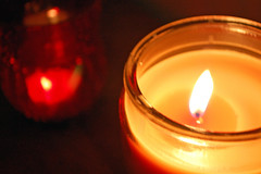 Pair Of Candles. (dccradio) Tags: lumberton nc northcarolina robesoncounty indoors inside candle candles burning illuminated flame redcandleholder candleholder tealightcandle jarcandle dark fire nikon d40 dslr circle round tealight red light candlelight