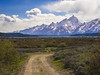 Teton Road (RobertCross1 (off and on)) Tags: 1250mmf3563mzuiko em5mkii grandteton grandtetonnationalpark jacksonhole mountainwest omd olympus rockymountains tetons wy wyoming bluesky clouds glacier lake landscape nature road snow