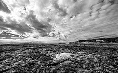 Rocky landscape (explored 24/12/17) (kurjuz) Tags: fessejrock ghawdex gozo malta mgarrixxini xattlahmar blackandwhite clouds perspective pools rocks rugged sea water wideangle
