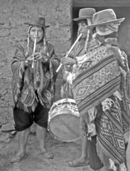 Musicians' last rehearsal.  Pisac- Cuzco (Lewitus) Tags: pisac cuzco 1982 fiesta traditionalclothing hats peru scannednegative hasselblad500c quenas musicalinstruments ponchos patio