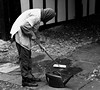 Street Cleaner (tcees) Tags: nikon d5200 1855mm bw mono monochrome blackandwhite broom wateringcan cobbles man boots streetphotography street urban cleaner pavingstones mermaidst rye sussex