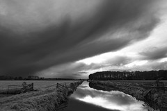 Black! (Alfred Grupstra) Tags: nature cloudsky blackandwhite landscape storm cloudscape water outdoors sky scenics dramaticsky overcast nopeople river sea ruralscene weather beautyinnature tranquilscene lake