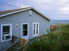 Little Grey Cottage, Kill Devil Hills, NC, 2009 (Tom Powell) Tags: outerbanks northcarolina contaxg2 zeiss28mmf28biogon film colorslide fujiprovia100f beach 2009