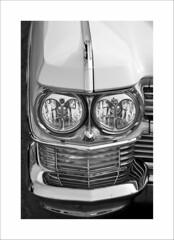 Caddy (DJ Wolfman) Tags: cadillac vintage classiccars details headlight blackandwhite bw olympus olympusomd em1markii 12100mmf4zuiko zuiko zd micro43 art