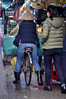 """""""Coming through..."""" (Roving I) Tags: womenworkers bicycles bikes nonla conicalhats paddedjackets markets loads hue vietnam vertical"""