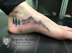 Nature mountain and trees foot tattoo by Wes Fortier @ Burning Hearts Tattoo Co. Waterbury, CT. Instagram: @wesdtc | Facebook: facebook.com/burningheartstattoo