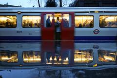 On reflection - the morning commute (Luke Agbaimoni (last rounds)) Tags: london londonunderground underground tube train transportforlondon trains transport rain streetphotography street station
