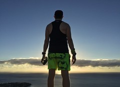 This morning was harder.  It's one thing to wake up in daylight, another to get up in darkness.  One thing to run with a friend, another to run alone.  To run in daylight, another to run in darkness.  From darkness to dawn I made it to Diamond Head, and i (tantek) Tags: npphotocontest novemberproject npsf sfrc grassrootsgear fromwhereirun today thismorning run runner solorun confident trailrun neverstopexploring getoutside dawn sunrise summit diamondhead diamondheadsummit crater diamondheadcrater waikiki honolulu oahu hawaii sun clouds ocean waves hills nofilter