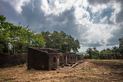 Storm Clouds Over the Slave Quarters (elrick.williams) Tags: 2017 28mmsummicron clouds conakry fotoba guinea leicam10 slaveisland trees buildings