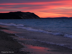 Beach Sunset (JamesEyeViewPhotography) Tags: beach lake michigan sunset water waves sky clouds reflections sand rocks greatlakes northernmichigan landscape nature december winter sleepingbeardunesnationallakeshore jameseyeviewphotography