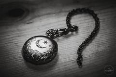 IMG_4696logo (Annie Chartrand) Tags: watch pocketwatch monochrome bw black white jewelry diamond star moon antique vintage circle chain wood time
