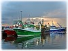 Greencastle, Co. Donegal. (willieguildea) Tags: greencastle donegal inishowen ireland eire ulster boats fishingboats trawlers harbour port quay water waterscape reflections sky clouds sunset nikon coast coastal coastalireland boat vessel