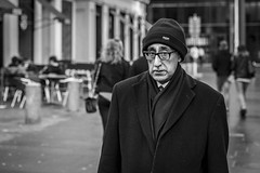Insulated (Leanne Boulton) Tags: portrait urban street candid portraiture streetphotography candidstreetphotography eyecontact candideyecontact candidportrait streetportrait streetlife man male face expression eyes look emotion mood glasses winter tone texture detail depthoffield bokeh naturallight outdoor light shade shadow city scene human life living humanity society culture people canon canon5d 5dmkiii 70mm character ef2470mmf28liiusm black white blackwhite bw mono blackandwhite monochrome glasgow scotland uk