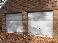 Pair of Hormann 2002 canopy doors with 4 point locking in Stone grey RAL 7035