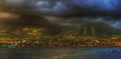Late afternoon thunderstorm over St. Kitts. (Fotofricassee) Tags: kitts mountains hills greenery vegetation shoreline thunderstorm ship cruise clouds