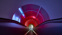 down the tube (Blende1.8) Tags: illuminated illuminiert farbig coloured colour colours colors escalator rolltreppe tube röhre symmetry symmetrie lines linie linien line red rot purple lila carstenheyer autostadt wolfsburg architecture architektur modern contemporary sony ilce7m2 variotessar16354za 1635mm interior indoors indoor vivid zeiss alpha emount blau blue