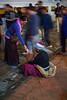 Tibetan woman giving money to beggar, Boudhanath, Kathmandu, Nepal