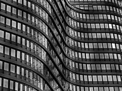 waves (heinzkren) Tags: fassade facade windows fenster schwarzweis blackandwhite bw monochrome architektur architecture lines linien kurven curves wien vienna öbb building gebäude hauptbahnhof bahnhof office bürogebäude pattern muster