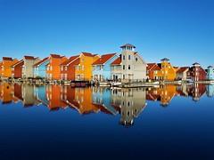 Colorful living (peeteninge) Tags: reitdiep groningen colorful houses reflections blue bluesky kleurrijk huizen reflecties blauw blauwelucht